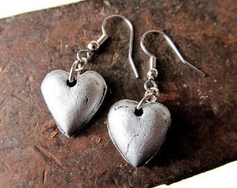 Heart shaped silver dangle earrings