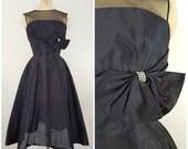 Vintage 1950s Black Cocktail Dress / Fancy Dress with Large Rhinestone Bow / Full Skirt / Black Tie Dress / XS