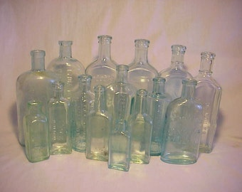 c1880s-1920s Collection of 15 Different Aqua Glass Embossed Cork Top Medicine, Bitters and Household Bottles No. 2