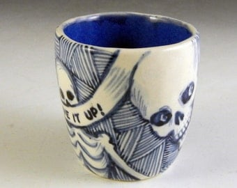 "Blue and white porcelain skeleton cup with ""Live it up"""
