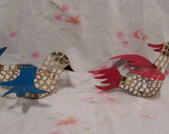 Strange, large, mirrored birds,  Christmas ornaments, who knows, handmade