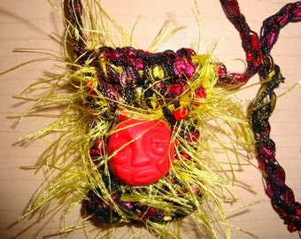 Red, Yellow and Black Crocheted Amulet Bag with Red Handmade Face Pendant