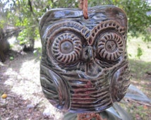 hanging owl bell,. green pottery owl