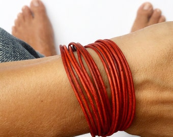leather bracelet triple wrap with lobster clasp chain with heart drop. Bohemian jewlery. you choose color.
