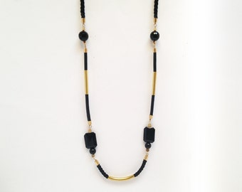 Long black necklace with beads, brass and leather