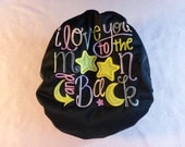 """SassyCloth one size pocket diaper with """"I love you to the moon and back"""" embroidery in girly colors on black PUL. Ready to ship."""