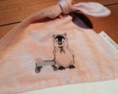 Organic baby girl knotted hat, peach and cream, 0-7 months, penguin in bear suit, bunny in wagon