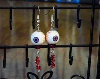 Purple and red eyeball earrings