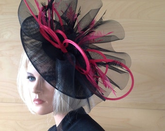 Black  saucer hat trimmed with bright pink satin loops and black crin chic designer handmade Wedding Races