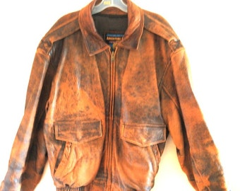 Fall fashion vintage 90s distressed rust, genuine leather heavy  jacket. Made by Adventure Bound, originals,Wilsons.Size Large.
