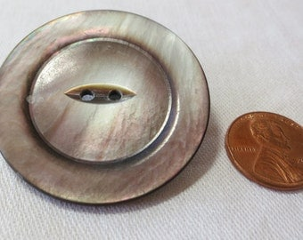"""Large vintage MOP button, fish eye, 2 hole 1.75"""" ins across. Dark base with silver, green, pink, grey water mark like colors. CLAM16.3-20.5"""