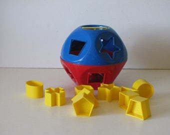 Vintage Plastic Tupperware Shape O Learning Toy - red and blue