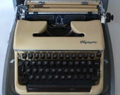 vintage Olympia typewriter, manual, butter yellow colored, with case, from Diz Has Neat Stuff
