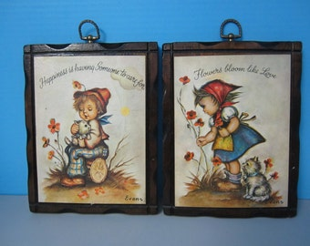 Pair of Hummel Style Kids Wall Plaques, Signed by Evans, Flowers Bloom Like Love and Happiness is Having Someone to Care For Made in U.S.A.