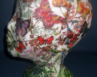 Mannaquin decoupage collage with wild flowers and butterflies.