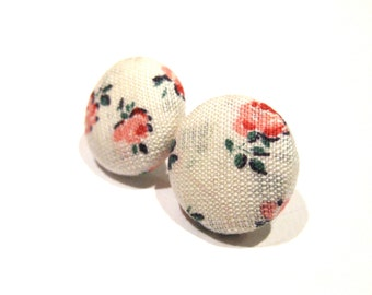 White fabric covored button earrings with a floral pattern in pink and green