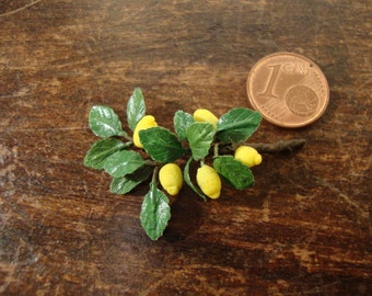 Miniature dollhouse branch of lemon tree with lemons