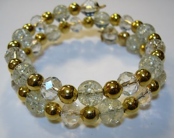 Crystal Clear and Gold Tone Beaded Bracelet on Gold Tone Memory Wire