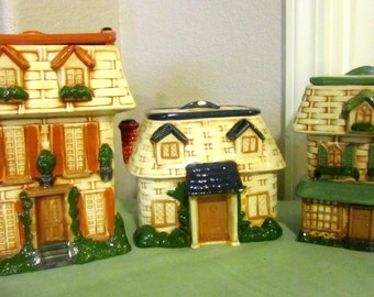 Three Beautifully Detailed Porcelain House Canisters