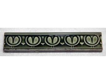 Set of green tulip trim tile