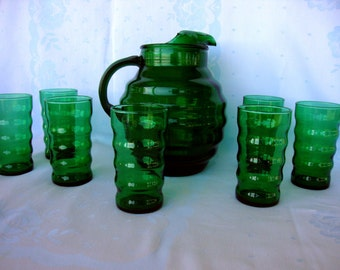 Vintage whirly twirly forest green glass pitcher and seven tumblers Anchor Hocking emerald hunter dark green glass
