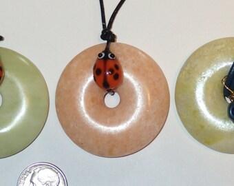 Gemstone Jade Donut Pendant with Glass Ladybug on Leather. One Pendant your choice