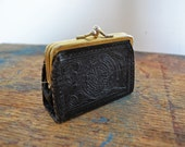 Vintage Mexican tooled black leather change purse with Aztec design