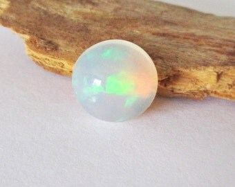 Ethiopian Welo Hydrophane  Opal 8mm Round Cabochon 1.30cts