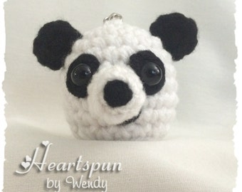 Panda Bear EOS Lip Balm Holder with clip to attach to a key chain, lanyard, purse, or bag. Hand crocheted, fits eos or similar lip balm.
