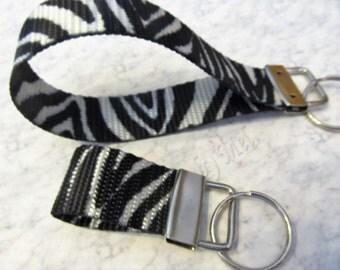 key chain, wristlet or finger fob, key ring, key holder, zebra stripes