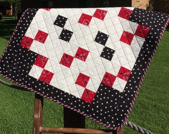 "Black With White Stars and Red Bandanas Are Altogether In This 30"" X 30"" Quilt"