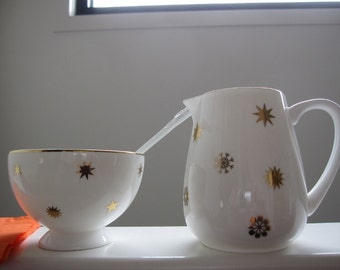 Hand decorated Jug bowl and spoon with gold stars