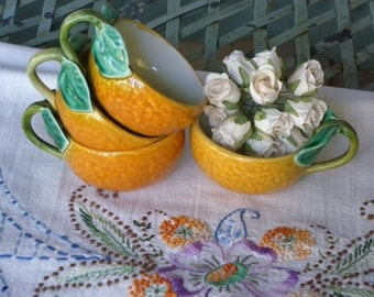 Set of Four Orange Small Cups with Green Leaf Stems as Handles