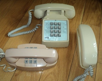 3 Vintage Telephones in Working Condition, A Tan Princess Touch Tone Phone, A Western Electric White Touch Tone Trimline Phone and  ROLM CRX