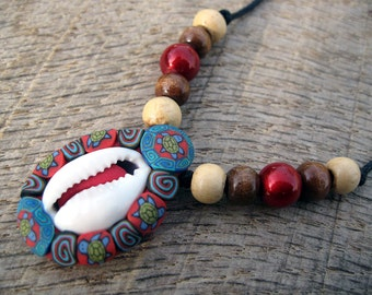 ON SALE Cowrie shell pendant with tribal turtle design, natural small cowrie shell and millefiori patterns in polymer clay, one of a kind