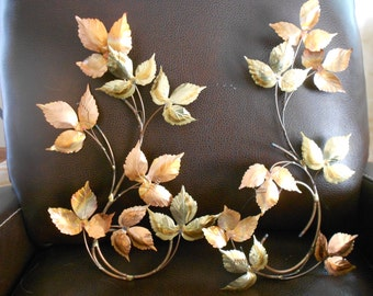 Vintage copper and brass wall art.