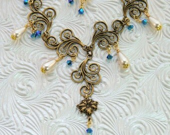 Antique brass rose and cream pearl necklace and earring set, vintage style Swirly Gig Capri blue and cream swarovski teardrop necklace set