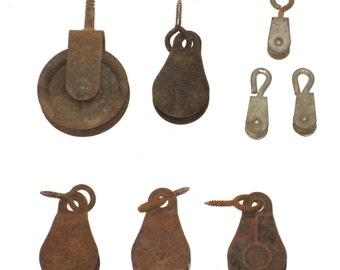 Vintage lot of pulleys re purpose rusty goodness