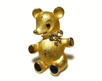 Adorable scruffy bear with bow and black eye, in matte and gloss gold tone finish