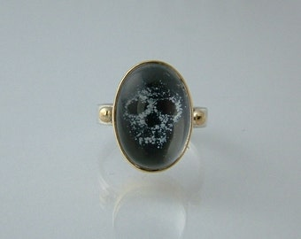 Sterling silver and 18ct gold memento mori enamelled skull ring.