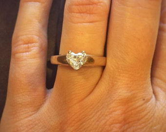 0.59 carat certified heart shaped diamond engagement ring. 14K yellow gold. Offering flexible layaway.