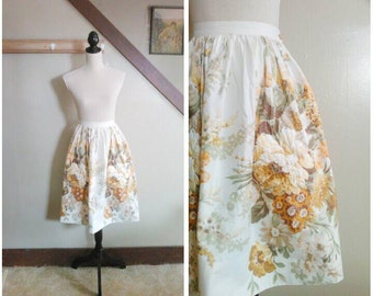 The Autumn Harvest 1950s Cream/Brown/Green/Gold Floral Print Skirt with Rhinestone Detail