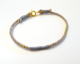 Light gray blue et gold color rope bracelet