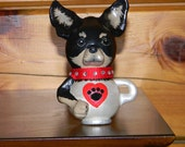 Chihuahua-in-a-teacup gourd figurine or ornament