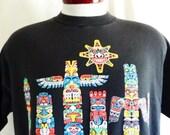 vintage 90's Alaska Totem Poles black graphic t-shirt bright multi-color iridescent glitter puffy print logo travel tourist souvenir Large