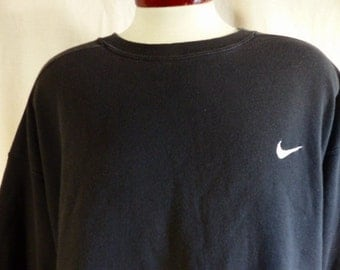 vintage 90's Nike solid black fleece graphic sweatshirt white embroidered swoosh logo crew unisex pullover jumper made in usa oversized XXL