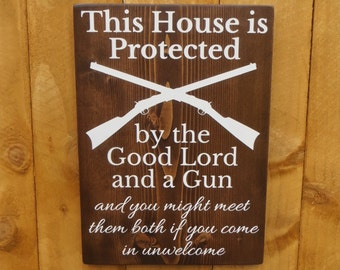 This House is Protected by the Good Lord and a Gun customizable rustic hand painted sign, hunting sign, outdoor sign, porch sign, home sign
