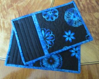 Beautiful blue and black mug rugs.