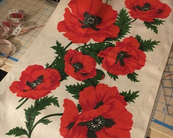 Large red poppies on natural linen
