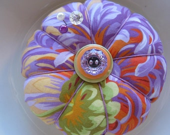 Pincushion.Pin cushion in Shaggy in purple by Phillip Jacobs